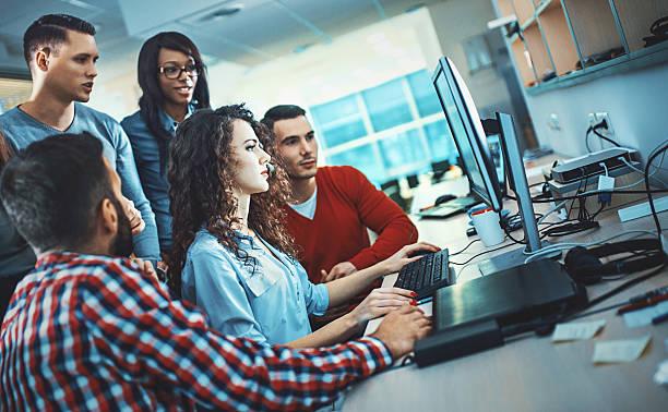 application developers at work. - człowiek maszyna zdjęcia i obrazy z banku zdjęć