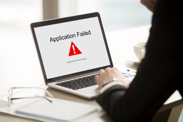 Application failed, businessman having problem with laptop, soft Application failed, businessman having problem with laptop, bad software failure on screen, broken computer stopped working in office, hanging pc caused system crash error message, close up rear view error message stock pictures, royalty-free photos & images