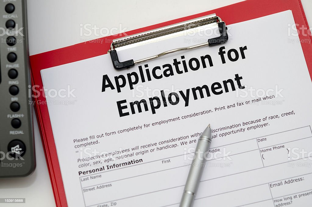 Application for employment on clipboard with pen stock photo