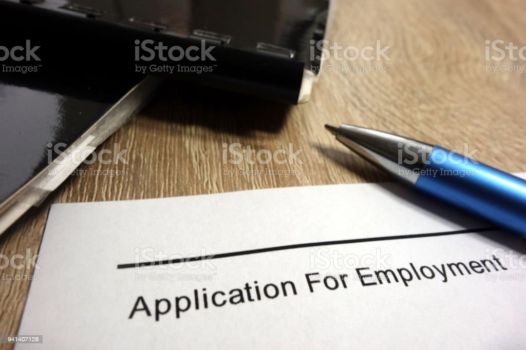 Application for employment, pen and briefcases stock photo