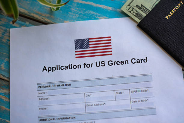 Application for United States of America green card Illustrative photograph of form for USA green card application green card stock pictures, royalty-free photos & images