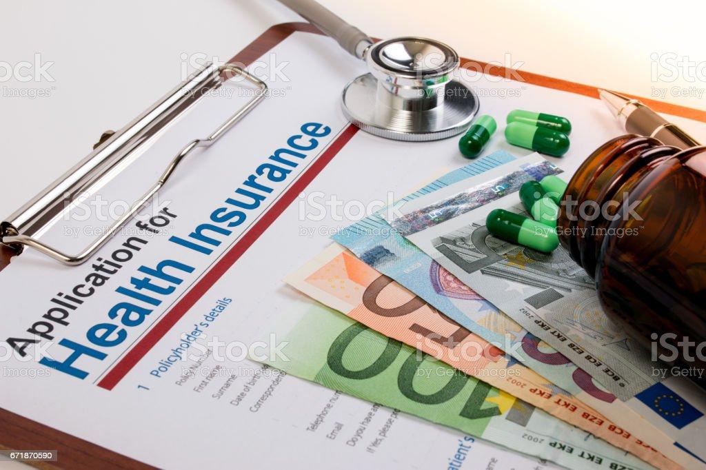 Application form for health insurance, paperwork, questionnaire, pen,...