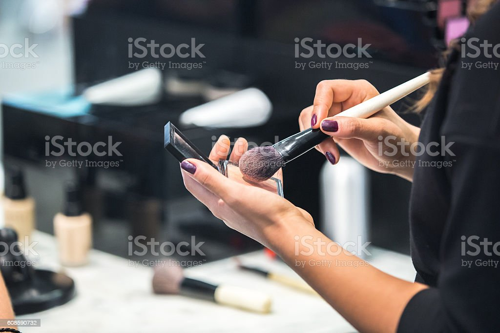 Application of makeup. foundation сream. stock photo