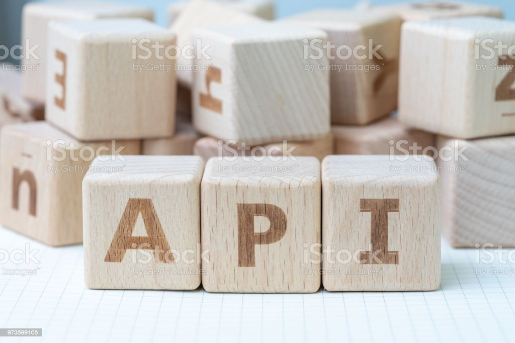 API, Application programming interface concept, cube wooden block with alphabet combine abbreviation API, technical term of middle thing to connect and sending data between computer and software stock photo