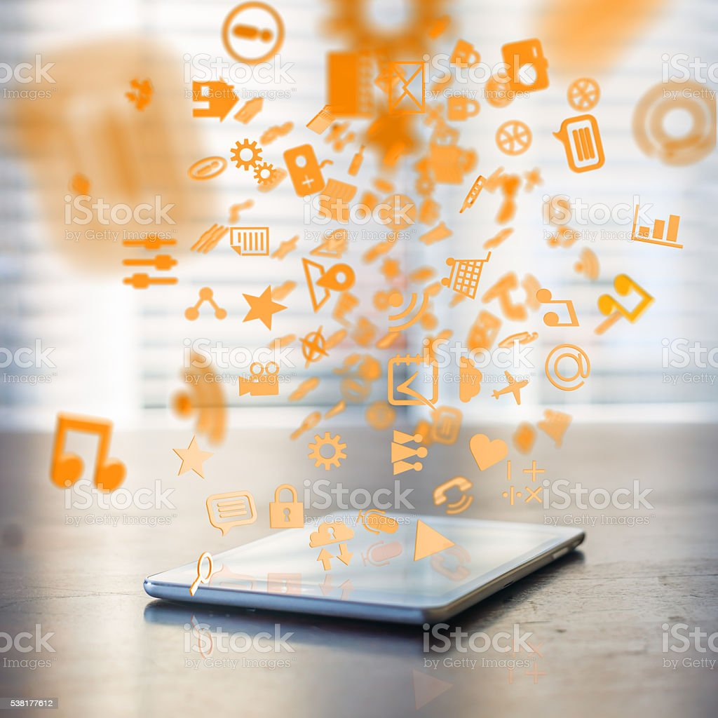 applications downloading into tablet computer stock photo