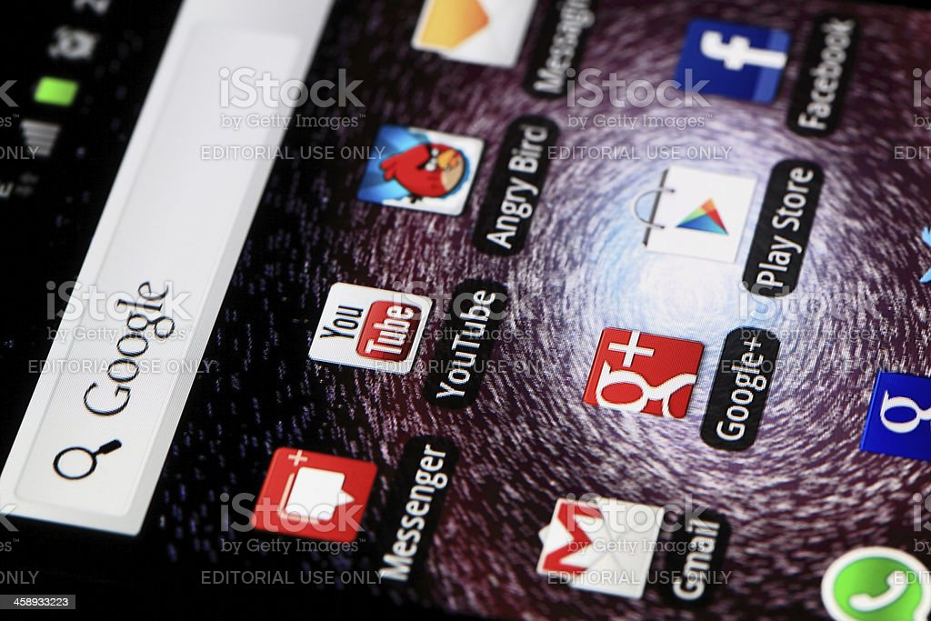 "Applications on Android ""Hong Kong, China - March, 19 2012: A close-up of a Samsung Galaxy S II Android screen with social media applications of Google Plus, Facebook, Play Store and Google Search."" Big Tech Stock Photo"