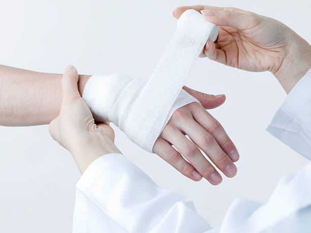 apply a bandage - medical dressing stock pictures, royalty-free photos & images