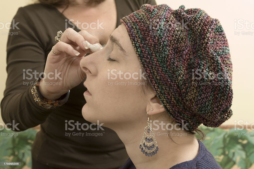 Apply concealer stock photo