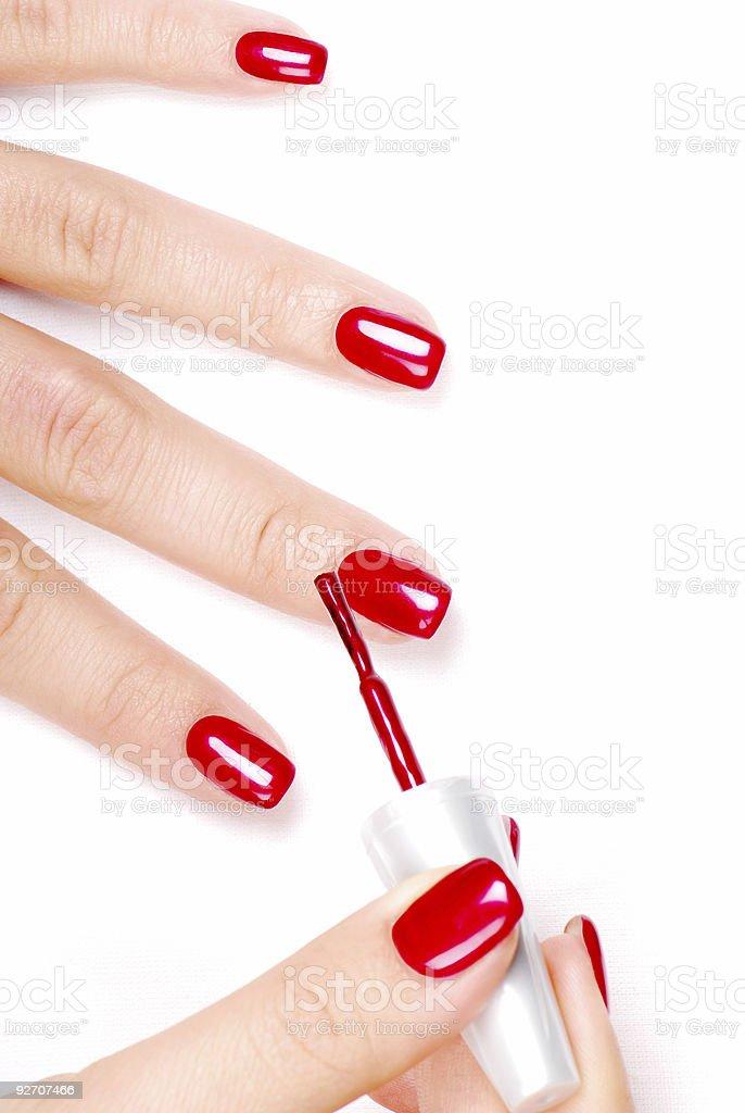 Apply nail polish royalty-free stock photo