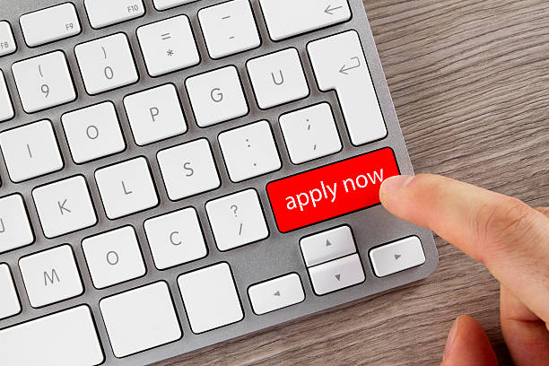 apply now button on computer keyboard - apply online stock photos and pictures