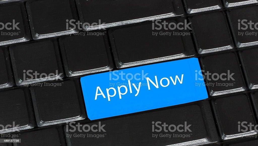 Apply Now computer key stock photo