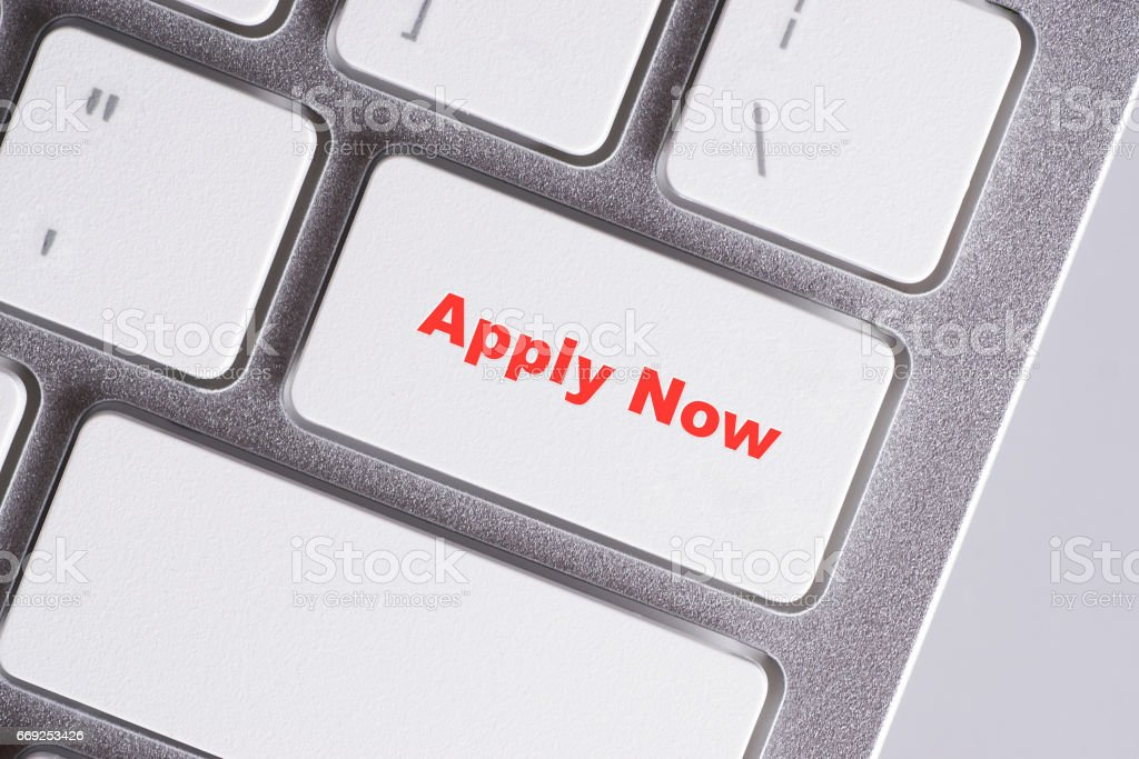 'Apply Now' red words on white keyboard - online, education and business concept stock photo