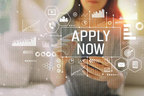 apply now with woman using a smartphone - mettersi lo smalto foto e immagini stock