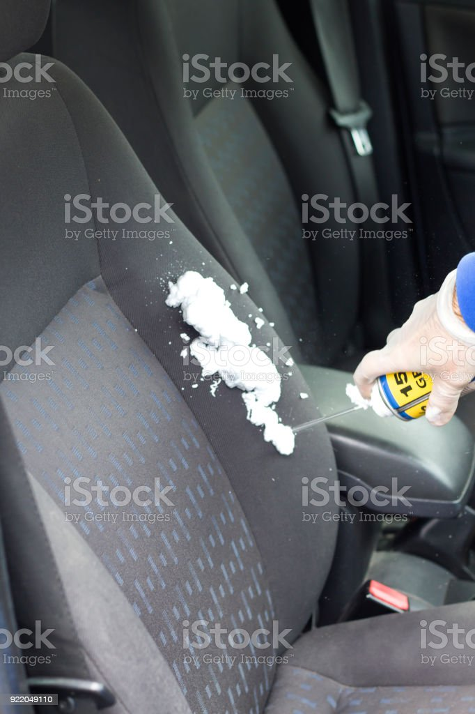 Apply upholstery foam to the seat backrest of a passenger car stock photo
