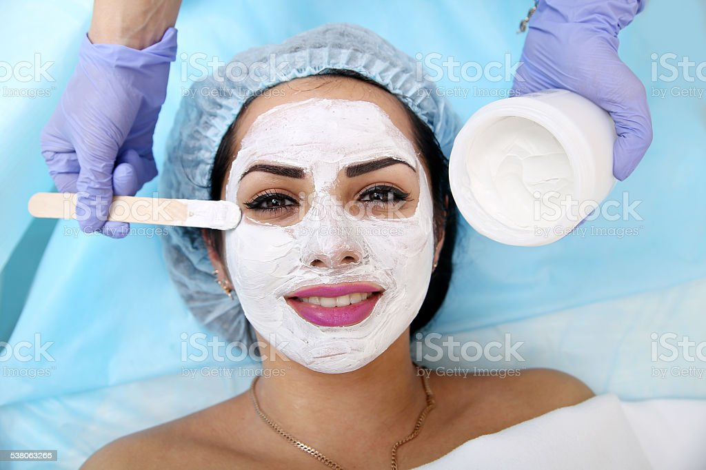 Applying a mask in the spa salon stock photo