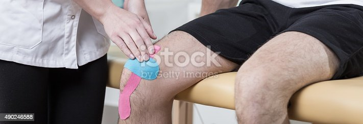 istock Applying adhesive bandage 490246588