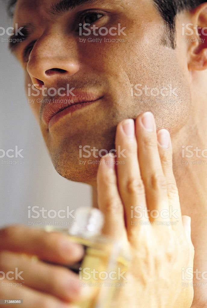 Applying aftershave stock photo