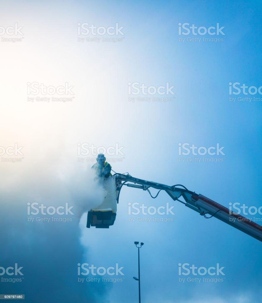 Applying antifreeze liquid to an airplane stock photo