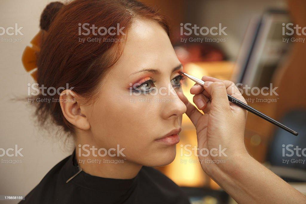Applying  art make-up stock photo