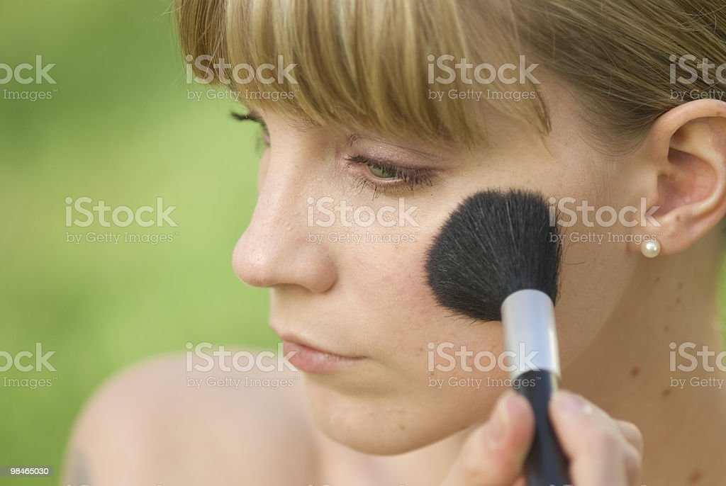 Applying blush make up royalty-free stock photo