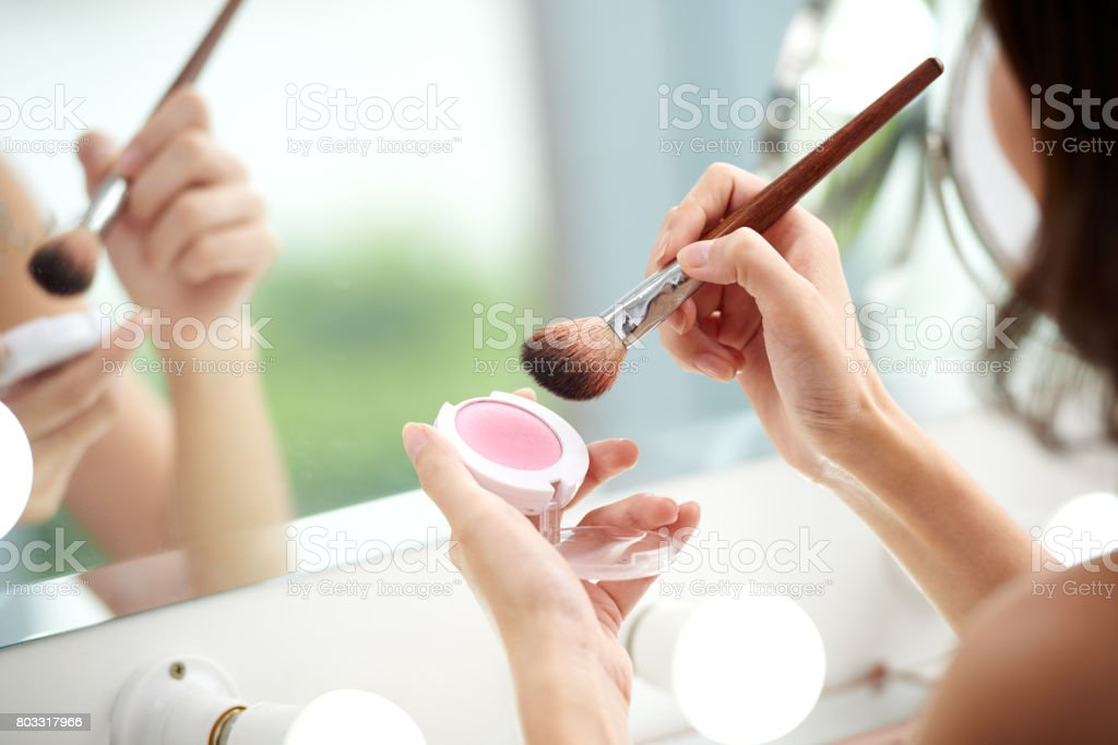 Applying blush stock photo