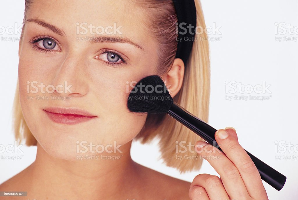 Applying blusher 免版稅 stock photo