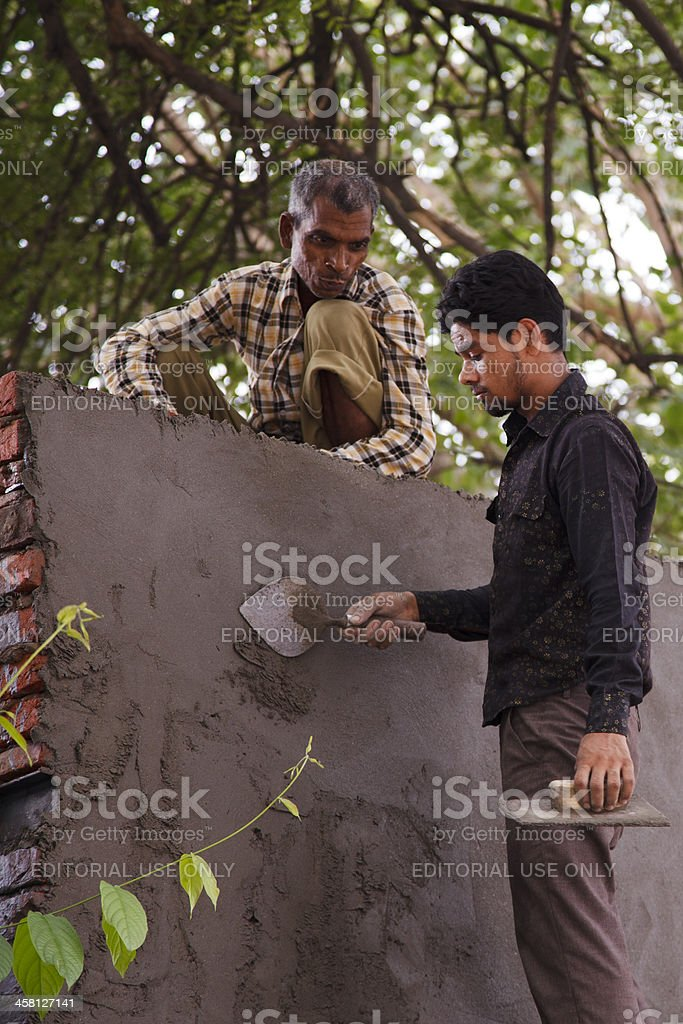 Applying Cement royalty-free stock photo