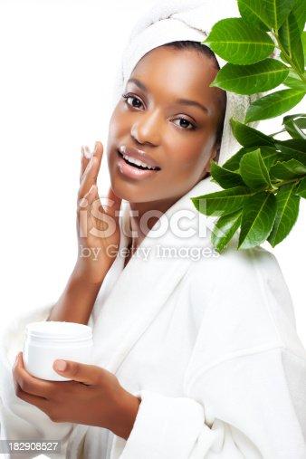 istock applying cream black woman 182908527