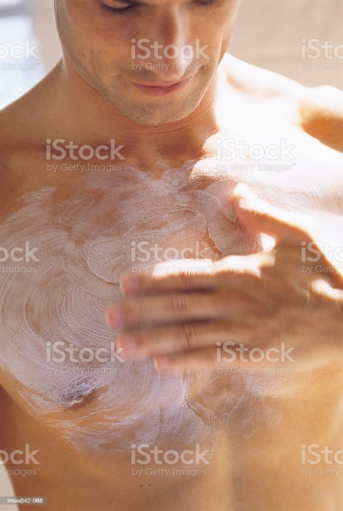 Applying cream royalty-free stock photo