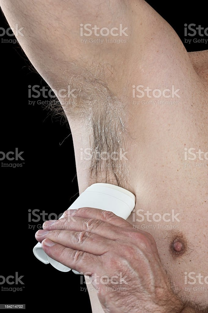 Applying deoderant stock photo