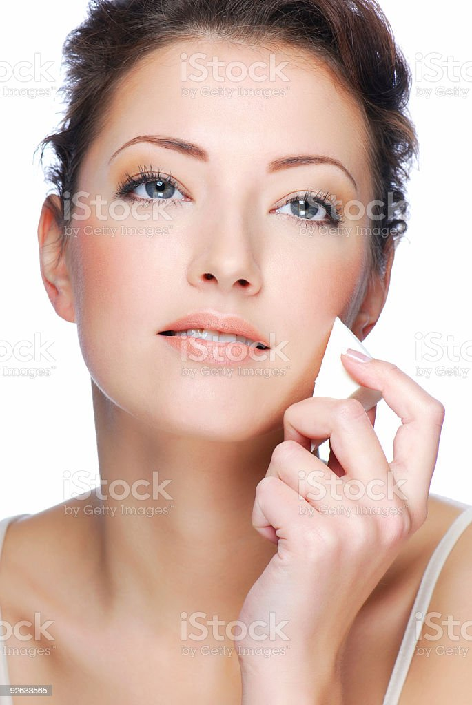 Applying face and body royalty-free stock photo