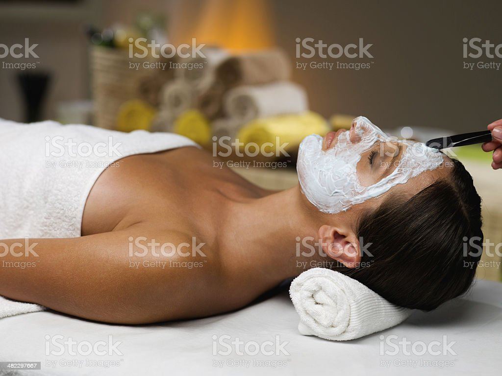 Applying face mask on spa treatment stock photo