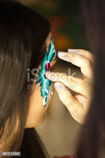 istock Applying face paint 687013392