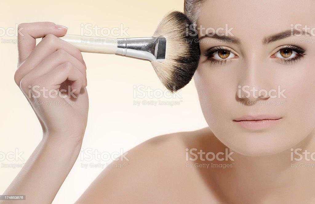 applying face powder royalty-free stock photo