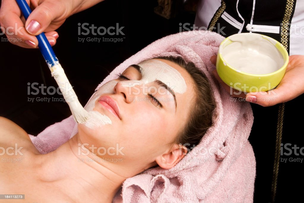 Applying facial mask royalty-free stock photo