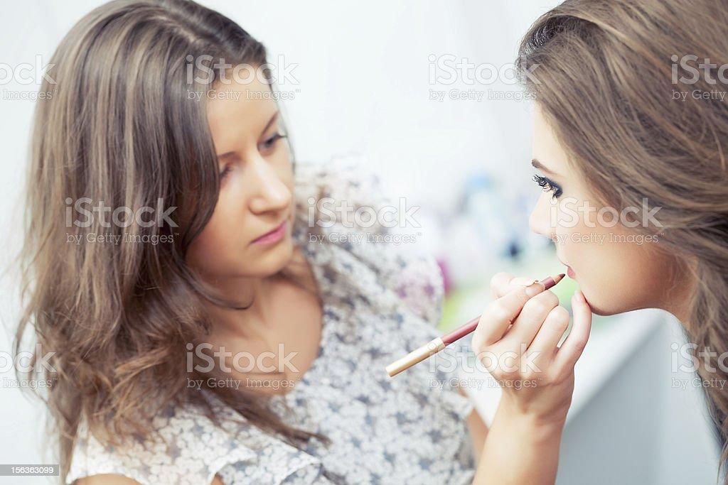 Applying lip liner royalty-free stock photo