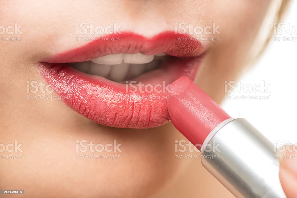 Applying lipstick - beauty concept stock photo