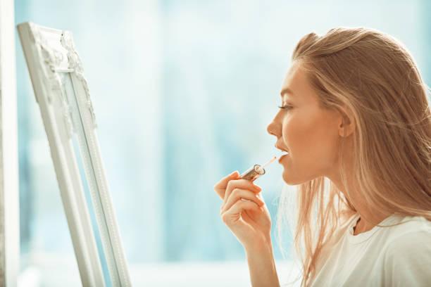 Applying lipstick... stock photo