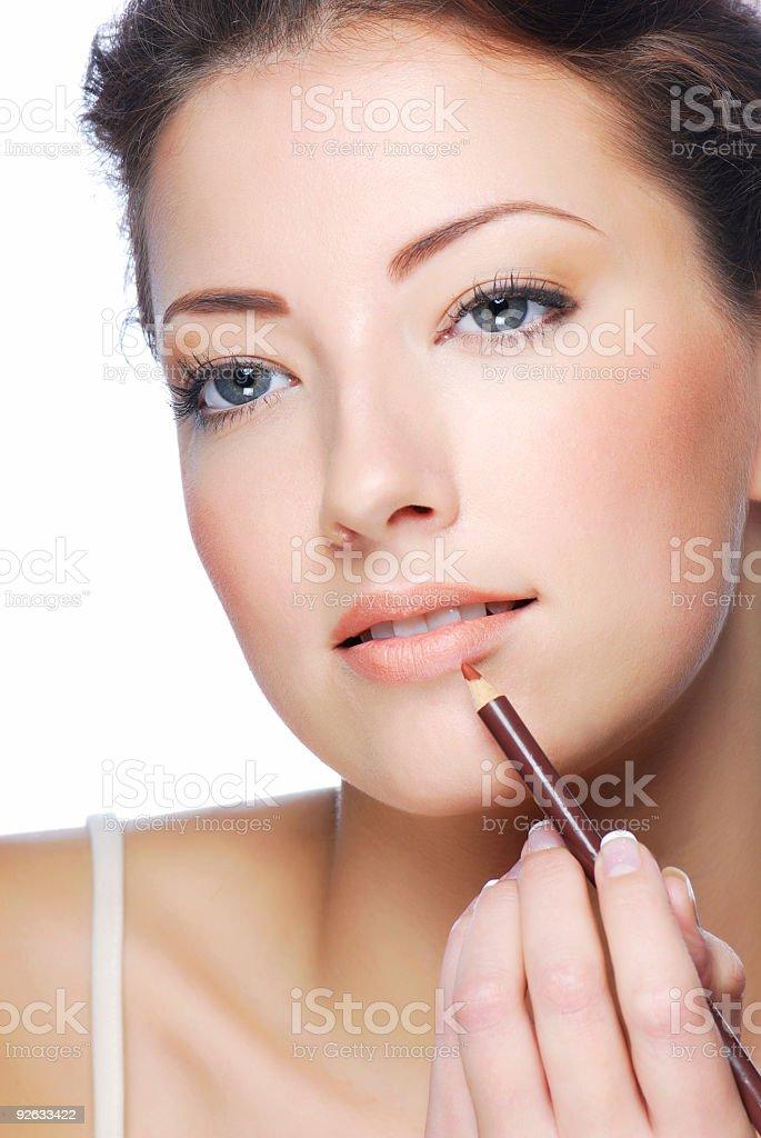 applying lipstick using lip concealer brush stock photo