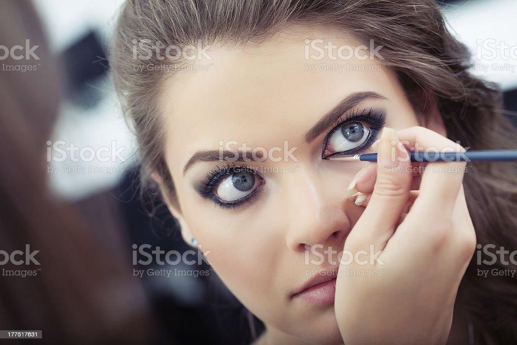 Applying liquid eyeliner stock photo