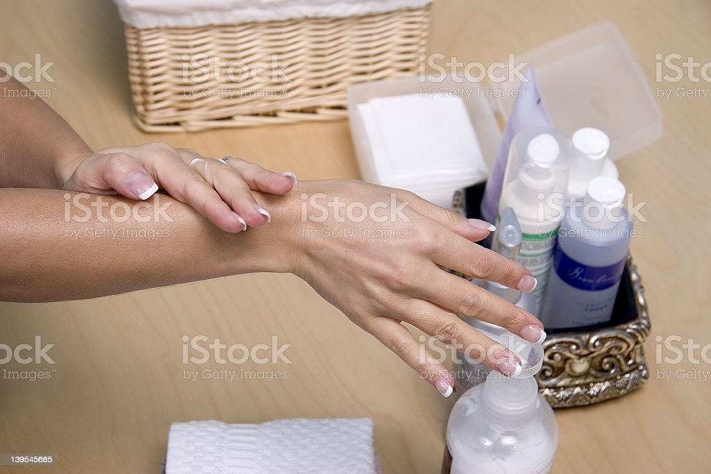 Applying lotion royalty-free stock photo