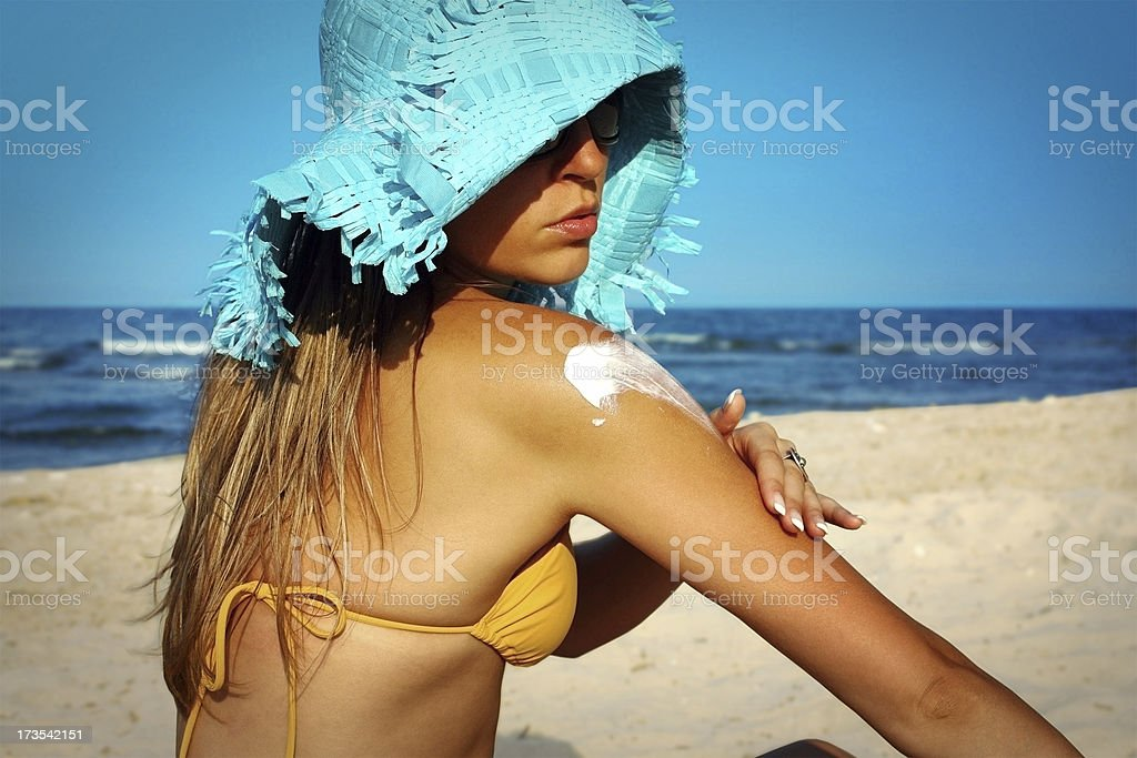applying lotion stock photo