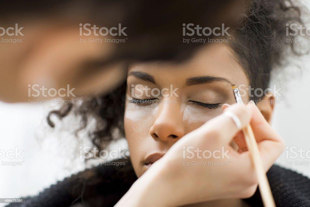 Applying make up. stock photo