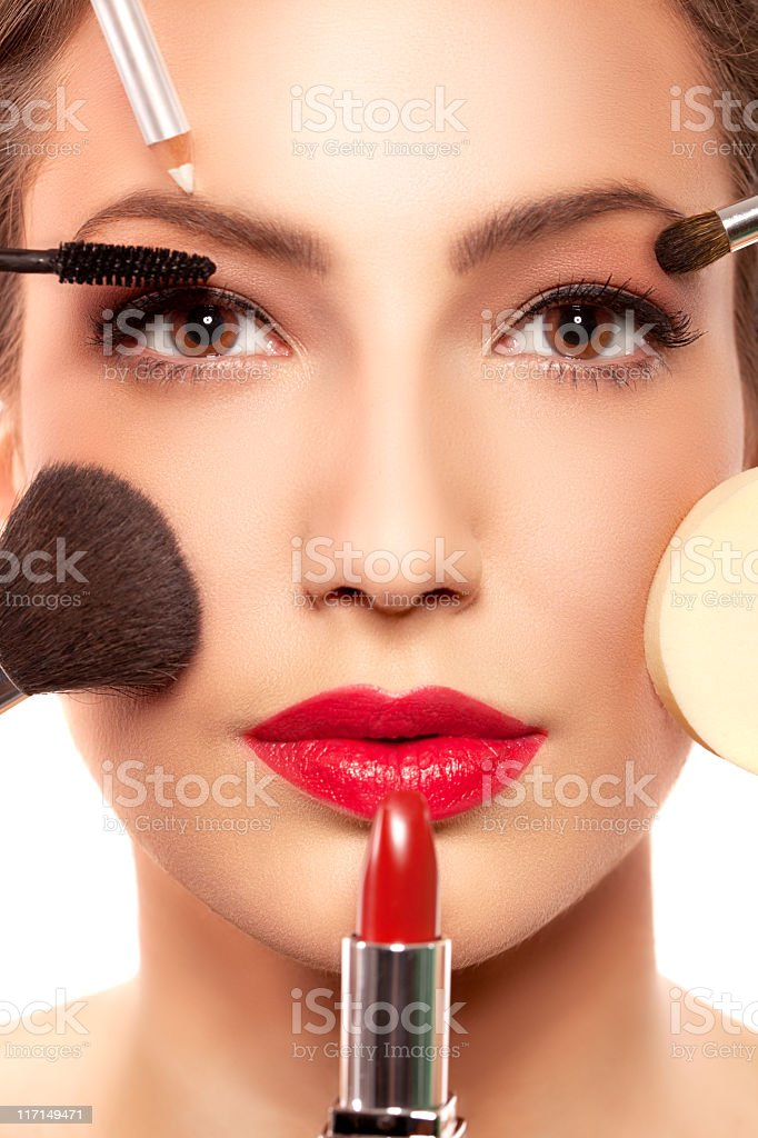 Applying make up professionally royalty-free stock photo