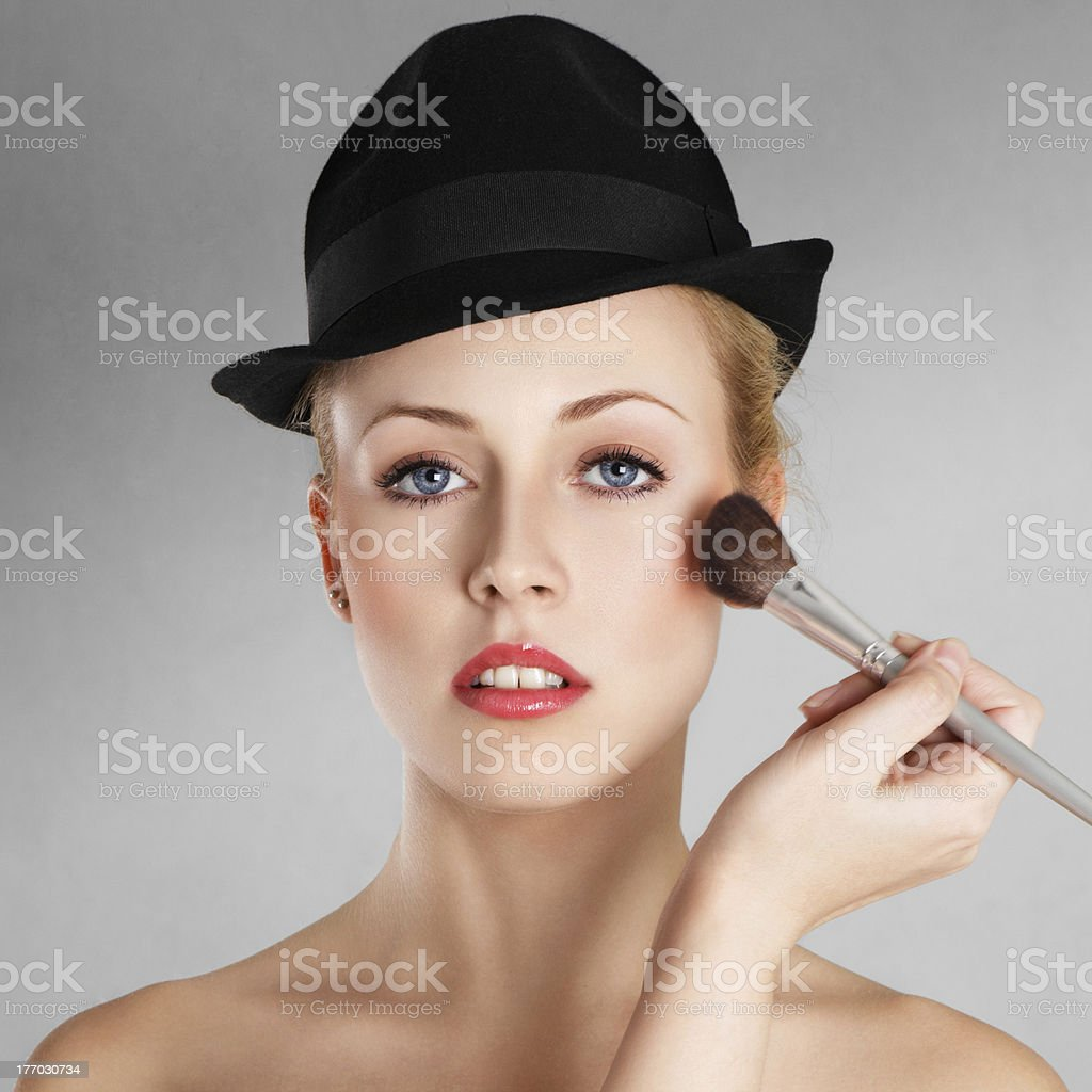 Applying make-up royalty-free stock photo
