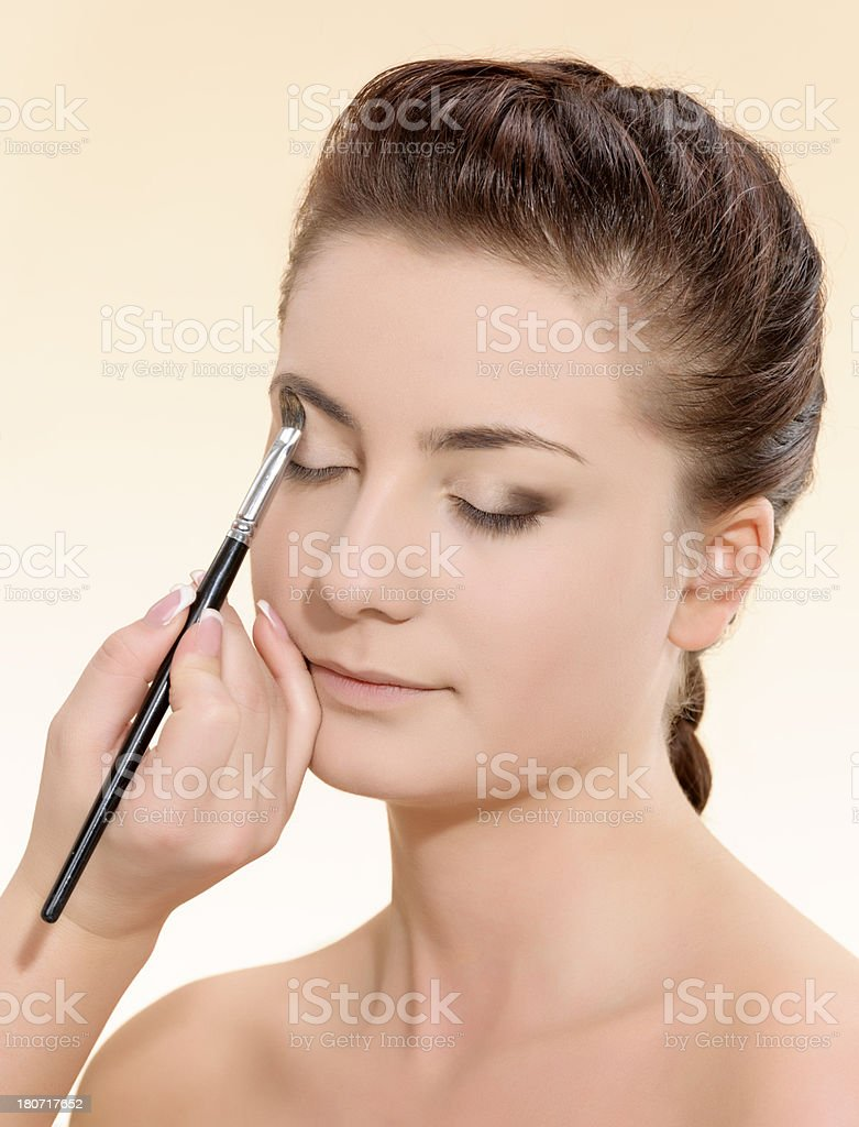 applying makeup royalty-free stock photo