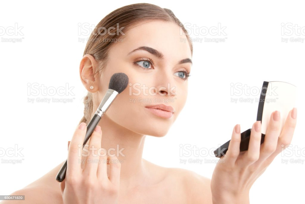 Applying makeup стоковое фото