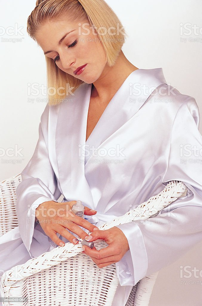 Applying nail polish royalty-free stock photo