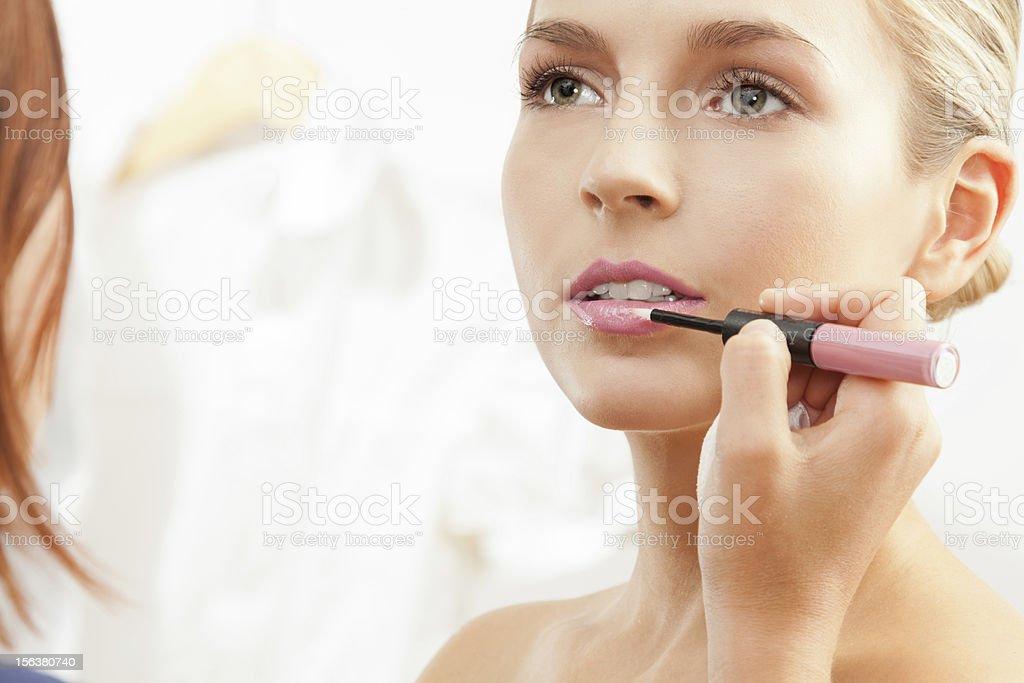 Applying pink lipglass royalty-free stock photo