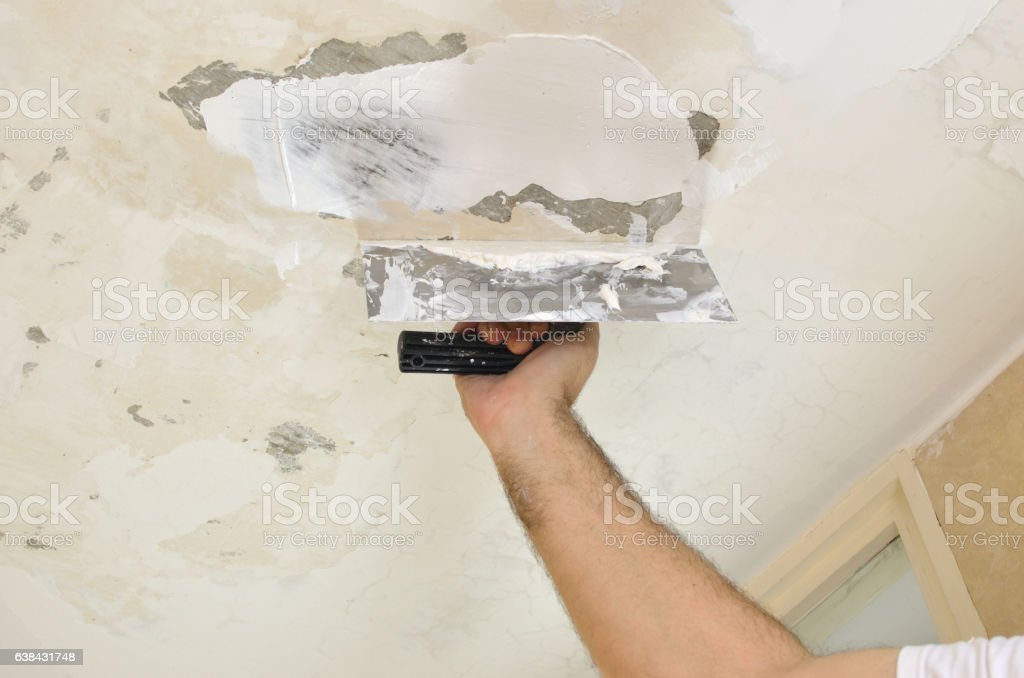 Applying Plaster to a Ceiling stock photo